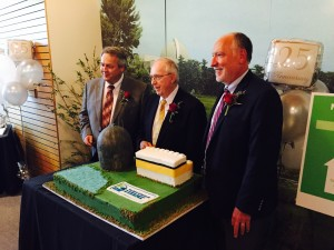 Dean Curtland, Ed Brown, and Ted Feigenbaum get ready to cut cake.